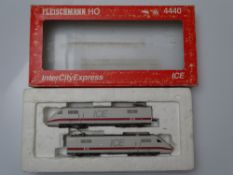 HO GAUGE MODEL RAILWAYS: A FLEISCHMANN 4440 2 car ICE power car set in DB white / red livery - G/