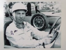 AUTOGRAPH: A black/white 10 x8 photograph signed by and featuring STIRLING MOSS - this item has been
