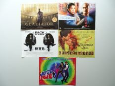 ACTION: A selection of movie memorabilia to include: Five mini posters featuring artwork based on
