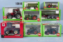 Konv. 6 landwirtschaftliche Fahrzeuge und 2 Anhänger, dabei International 956XL, Deutz D 9005,