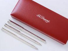 DUPONT Ensemble en métal argenté composé d'un stylo à bille, d'un roller et d'un [...]