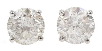 Pair of 18ct white gold diamond stud earrings, stamped 750, diamond total weight 3.52 carat