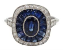 Platinum sapphire and diamond ring, the central oval sapphire surrounded by halo of calibre cut