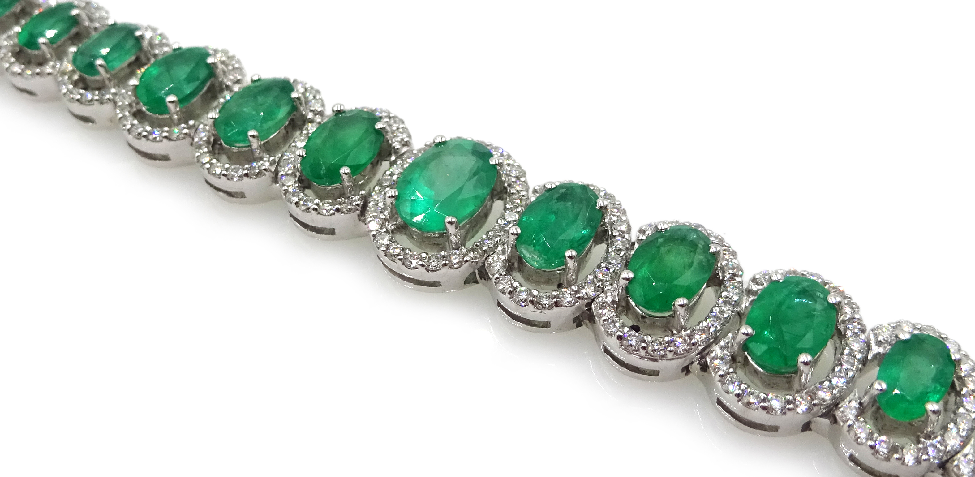 18ct gold graduating oval emerald bracelet, each emerald surrounded by brilliant cut diamonds, total - Image 4 of 5