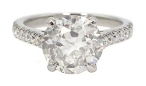 Platinum old cut diamond solitaire ring with diamond set shoulders, hallmarked, central diamond 2.10