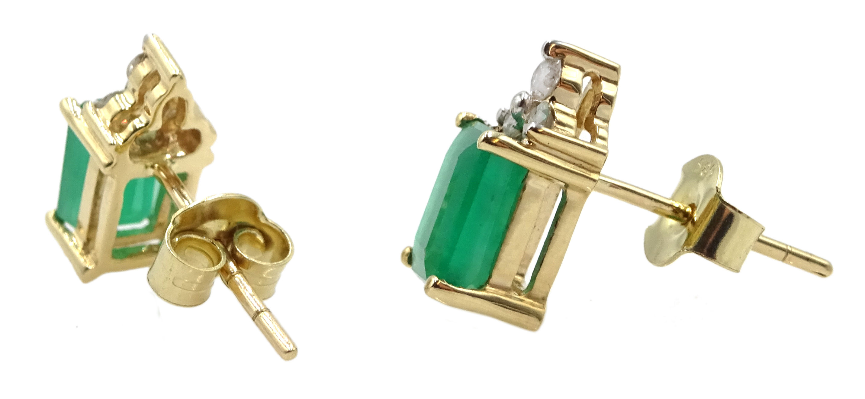 Pair of 14ct gold emerald and diamond stud earrings, stamped 585, emerald total weight approx 1.95 - Image 2 of 2