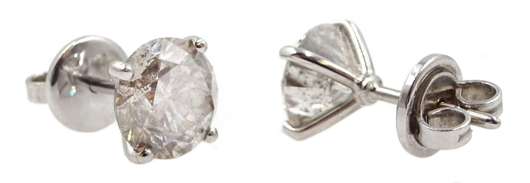 Pair of 18ct white gold diamond stud earrings, stamped 750, diamond total weight 3.52 carat, free UK - Image 2 of 4