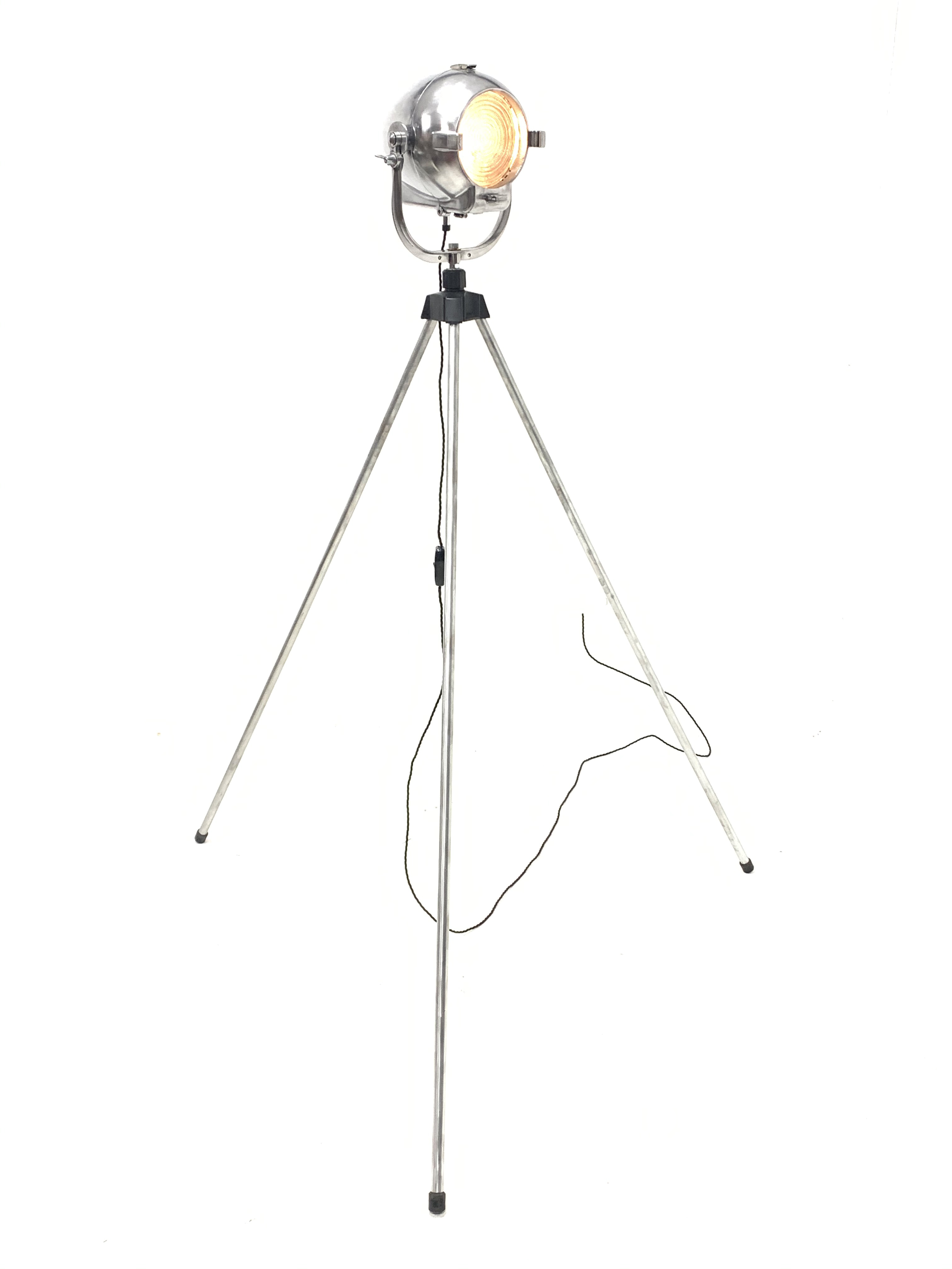 Mid 20th century 'Rank Strand' polished alloy stage light mounted on tripod base, H169cm, shipping
