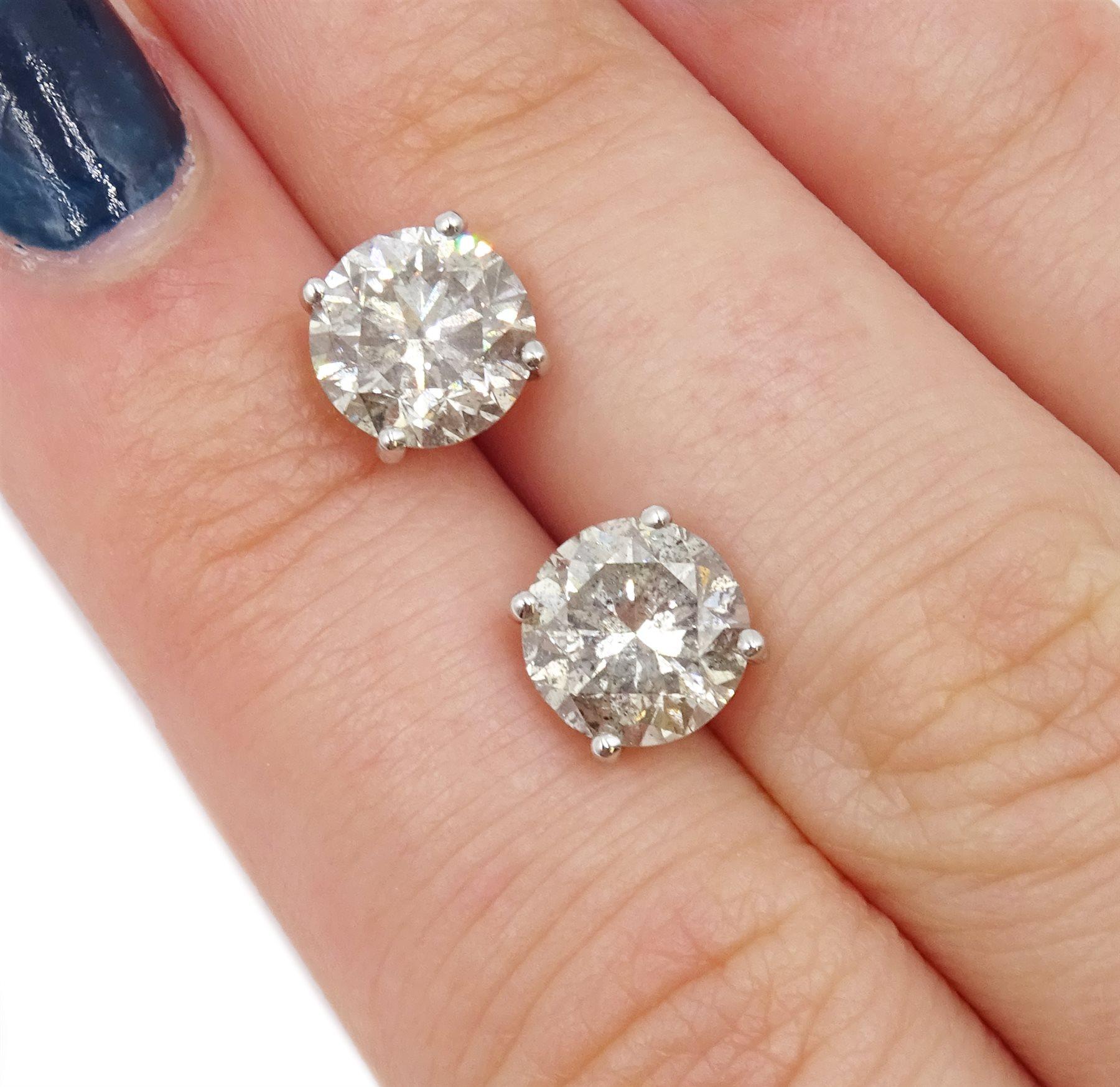 Pair of 18ct white gold diamond stud earrings, stamped 750, diamond total weight 3.52 carat, free UK - Image 4 of 4