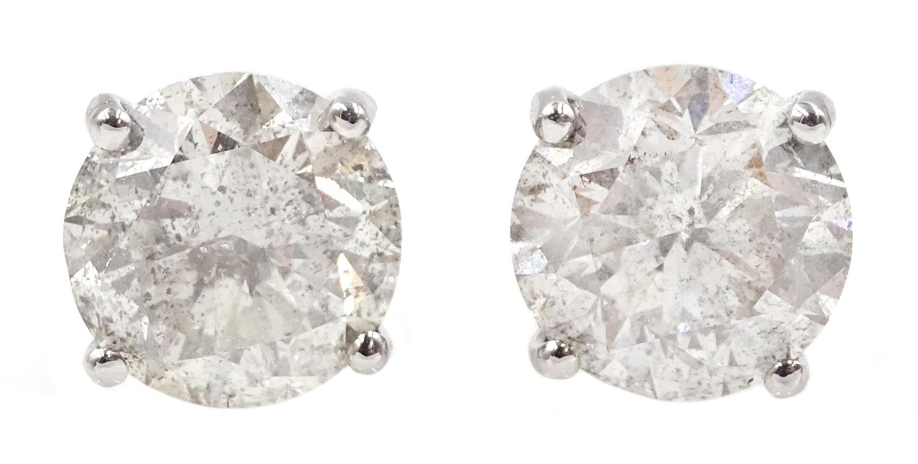 Pair of 18ct white gold diamond stud earrings, stamped 750, diamond total weight 3.52 carat, free UK
