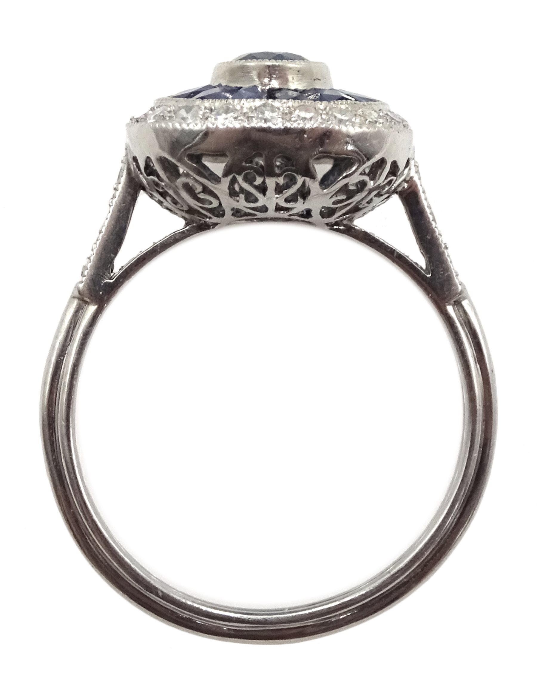Platinum sapphire and diamond ring, the central oval sapphire surrounded by halo of calibre cut - Image 4 of 5