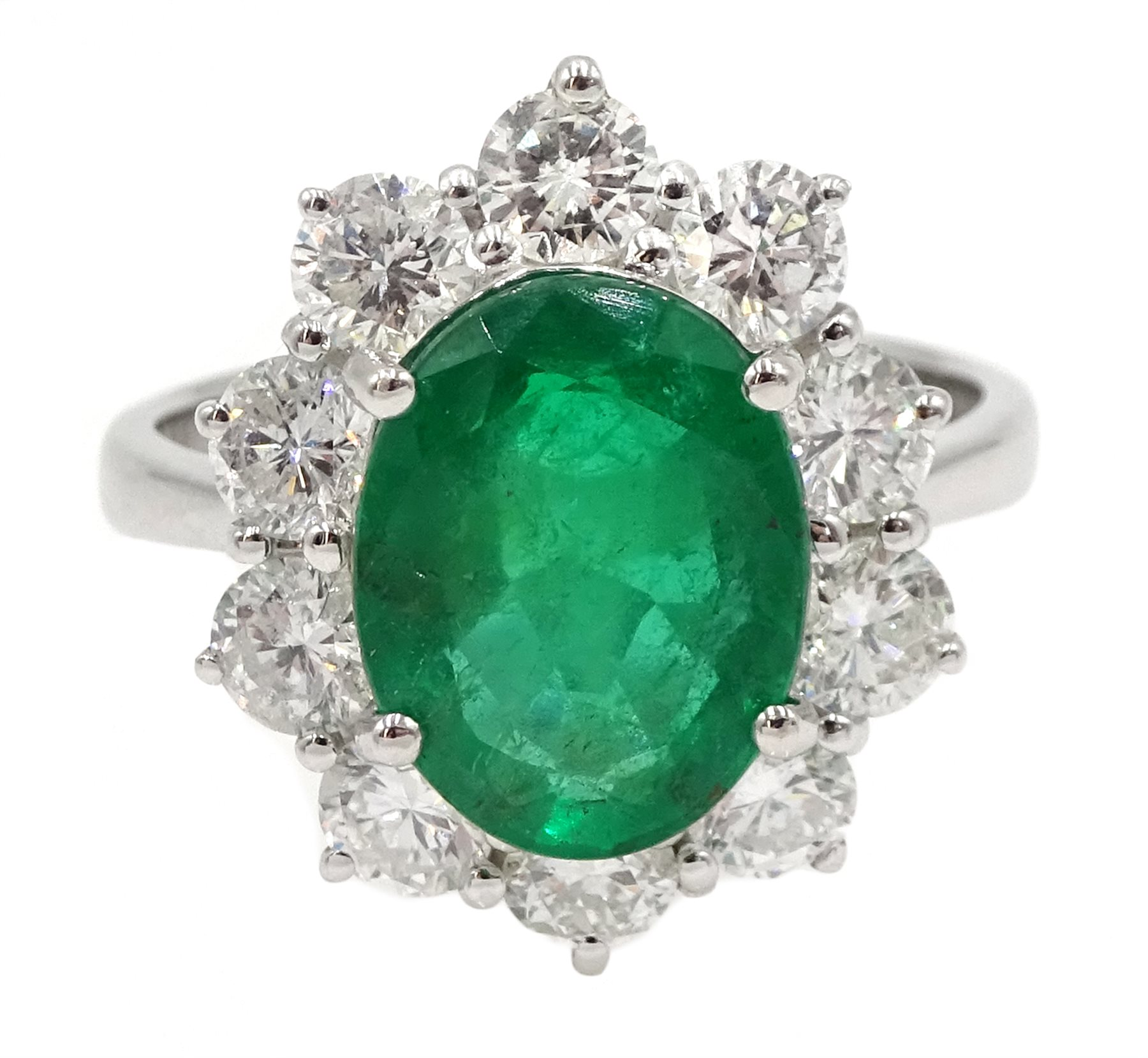 White gold oval emerald and round brilliant cut diamond ring, stamped 750, emerald approx 2.80