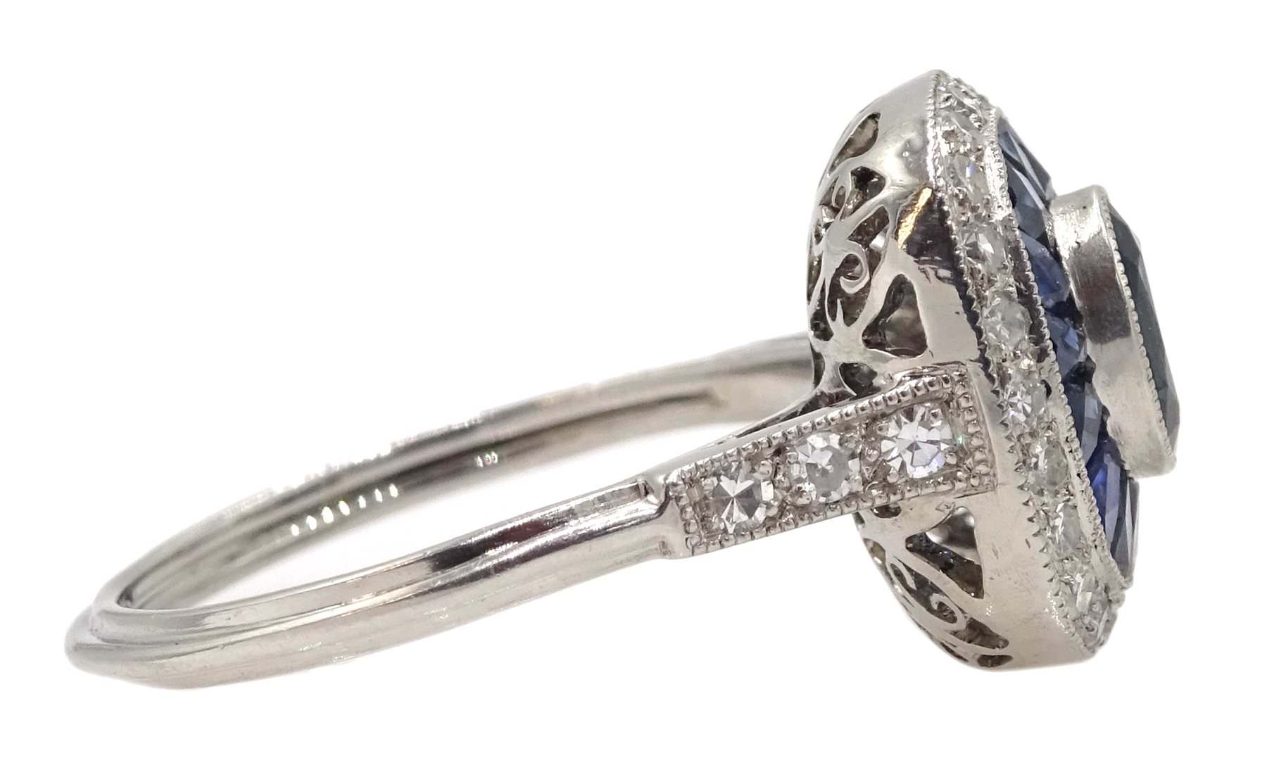 Platinum sapphire and diamond ring, the central oval sapphire surrounded by halo of calibre cut - Image 5 of 5