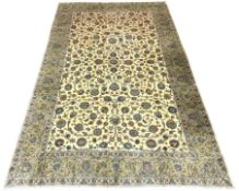 Large Persian Kashan carpet, ivory ground with interlacing foliage, decorated with stylised flower
