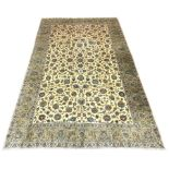 Large Persian Kashan carpet, ivory ground with interlacing foliage, decorated with stylised flower