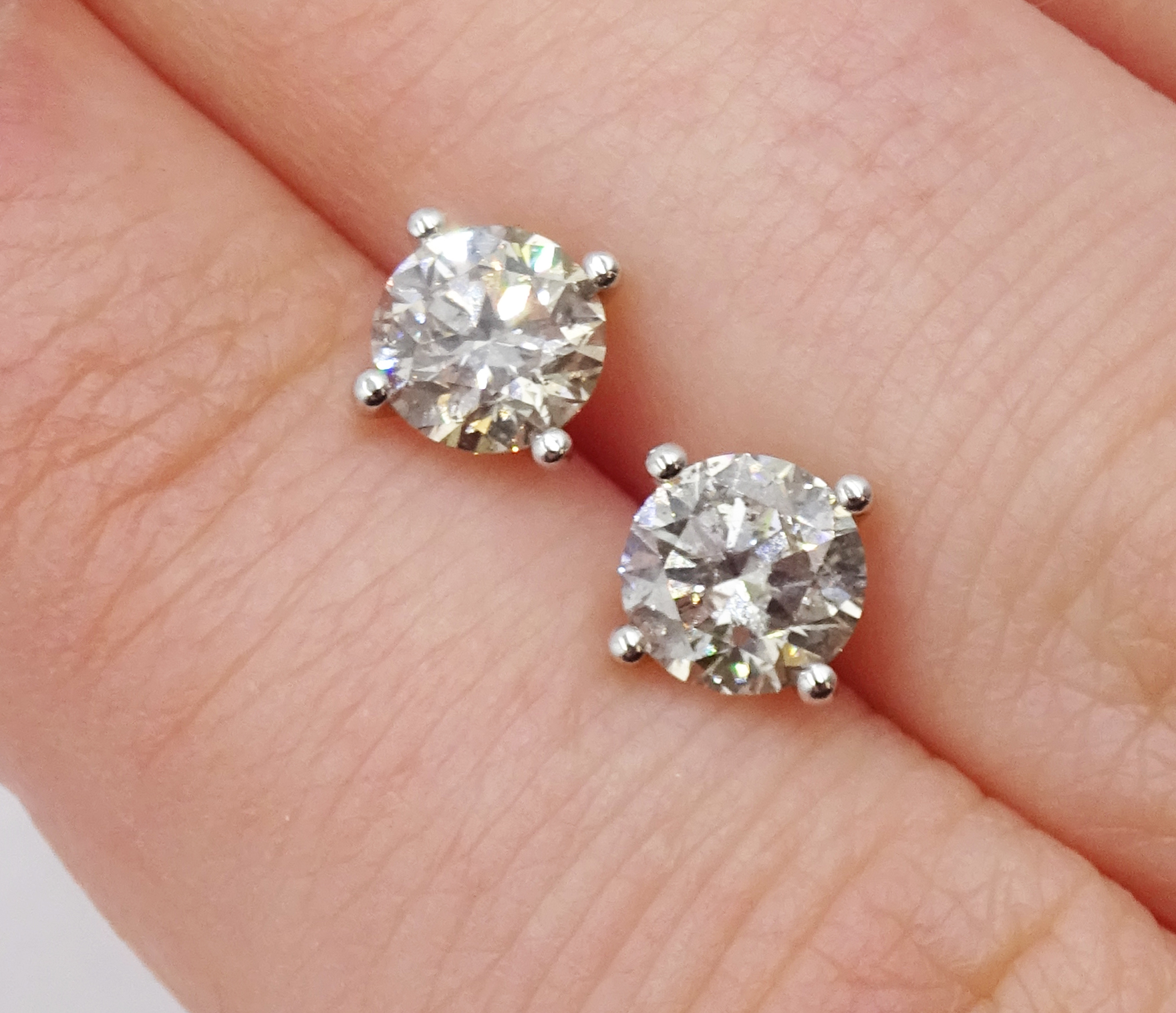 Pair of 18ct white gold brilliant cut diamond stud earrings, stamped 750, total diamond weight - Image 3 of 3