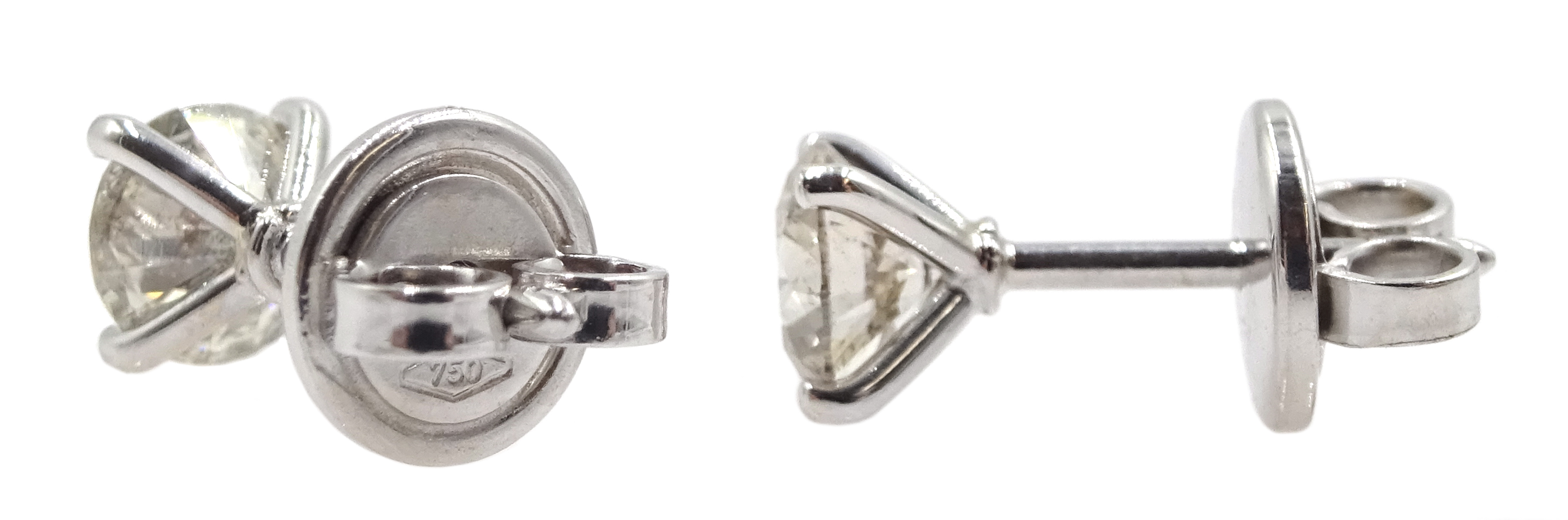 Pair of 18ct white gold brilliant cut diamond stud earrings, stamped 750, total diamond weight - Image 2 of 3