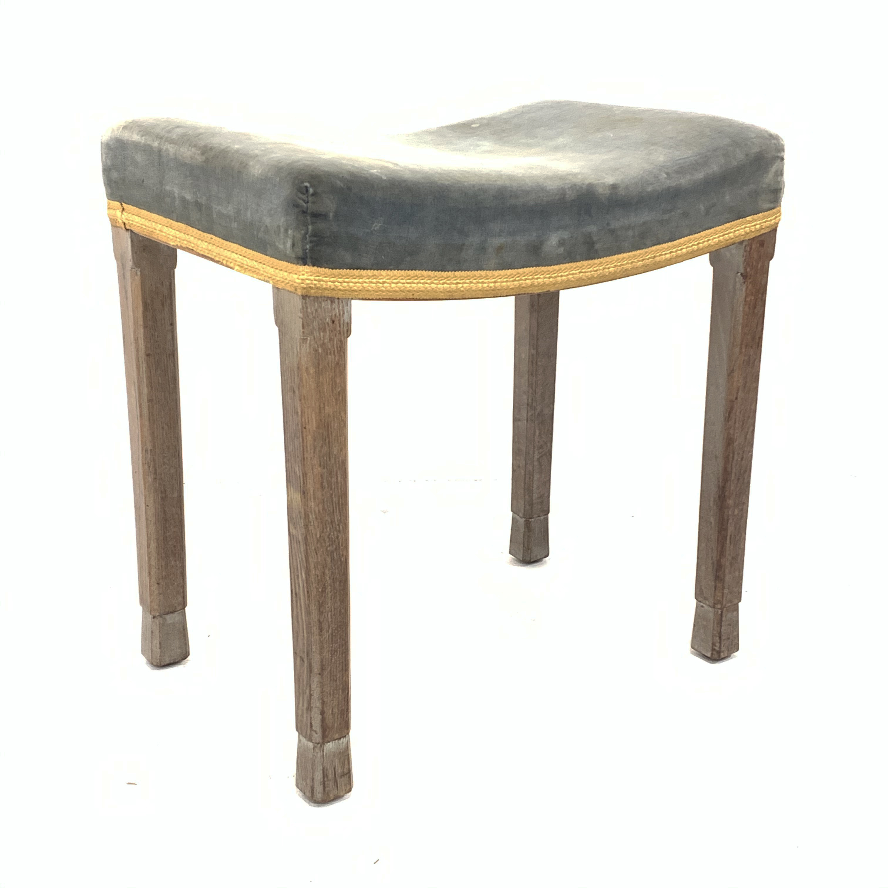 Elizabeth II limed oak Coronation stool with upholstered seat, stamp to the interior seat rail, with