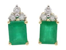 Pair of 14ct gold emerald and diamond stud earrings, stamped 585, emerald total weight approx 1.95