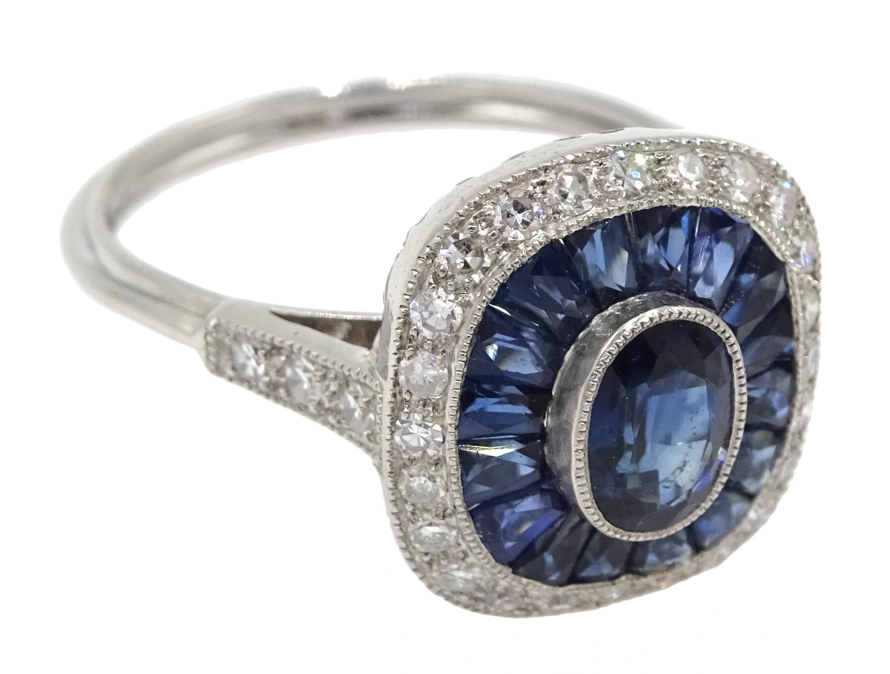 Platinum sapphire and diamond ring, the central oval sapphire surrounded by halo of calibre cut - Image 3 of 5