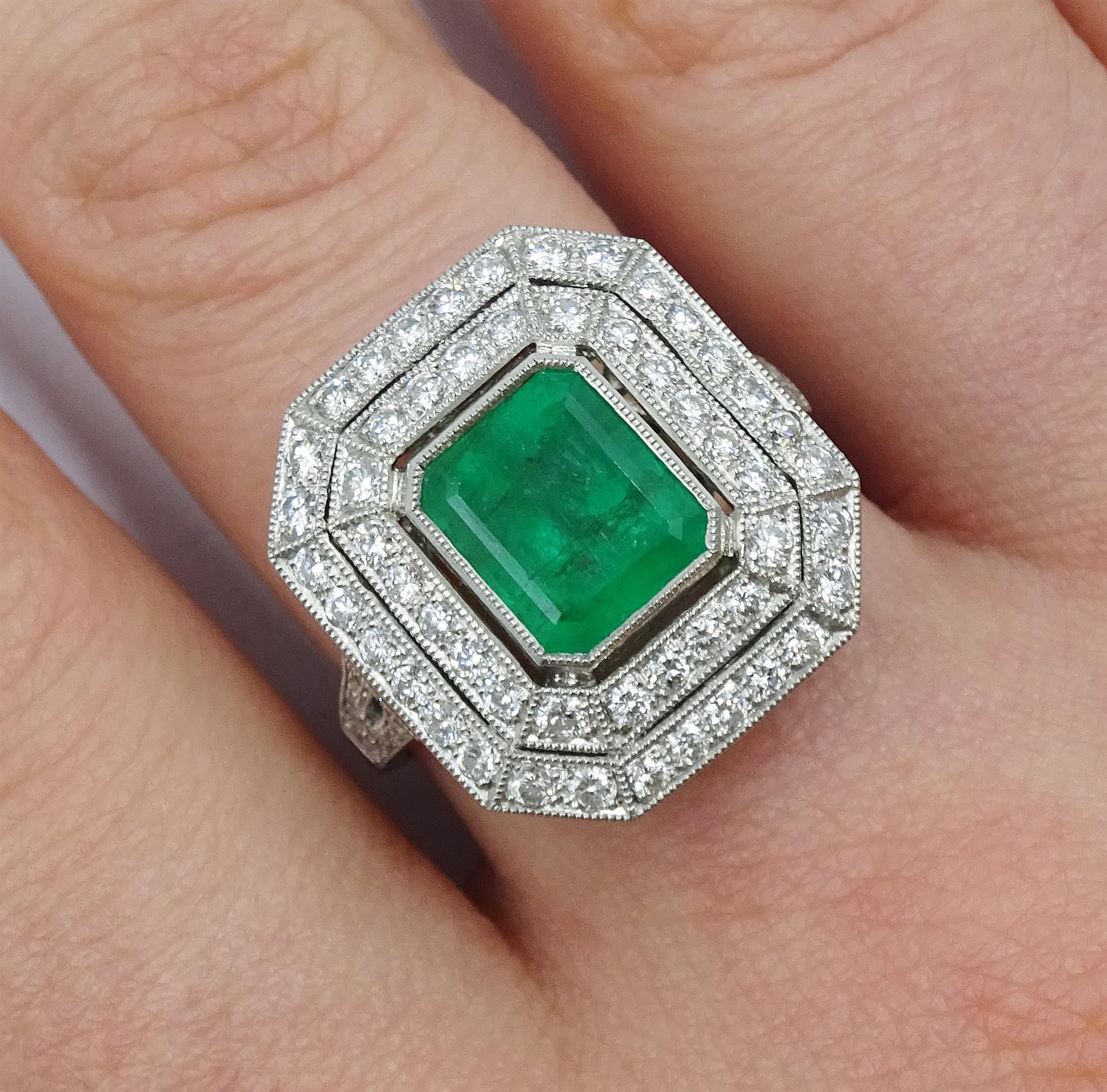 Platinum emerald and double row diamond ring, with diamond set shoulders, emerald approx 1.85 carat, - Image 2 of 5