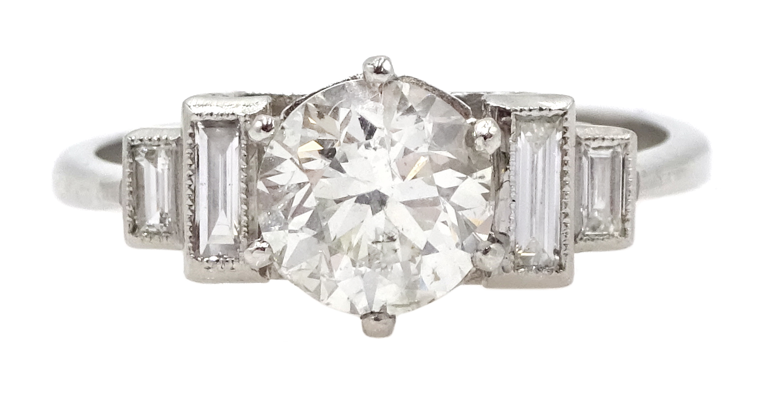 Art Deco style platinum ring set with central old cut diamond and diamonds to shoulders, central