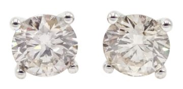 18ct white gold four claw solitaire diamond stud earrings, diamond total weight approx 1.00 carat,