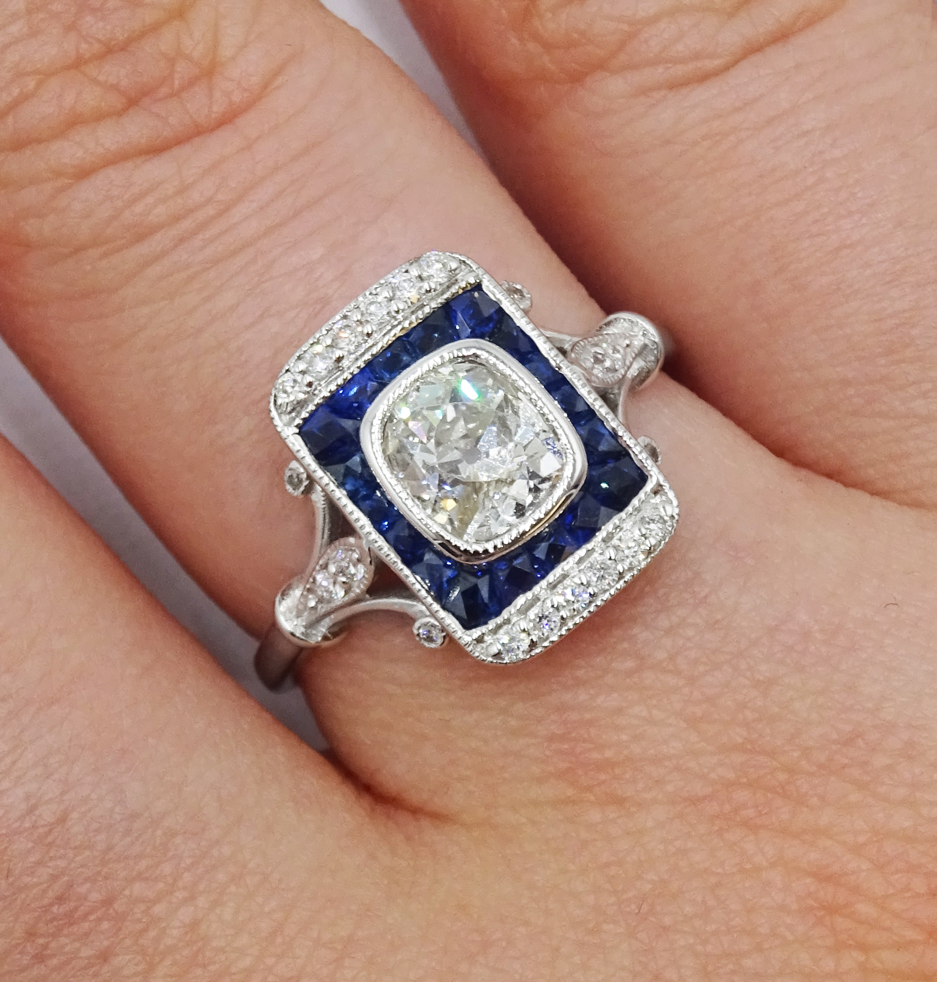 Art Deco style 18ct white gold, sapphire and diamond ring, central old cut diamond surrounded by - Image 2 of 6