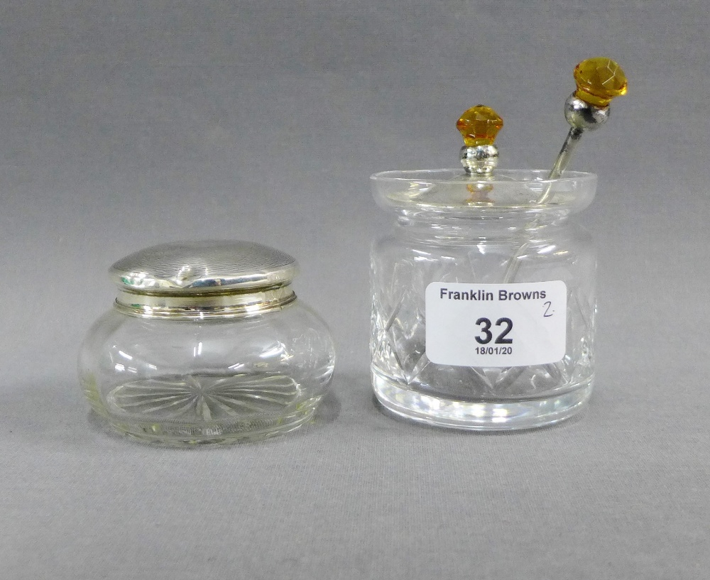 Lot 32 - London silver topped glass jar together with a glass preserve jar with Epns cover and spoon (2)