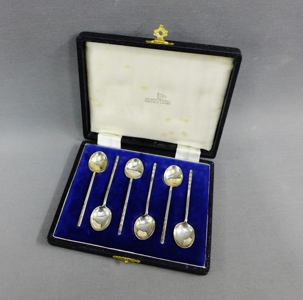 Lot 43 - A cased set of six Walker & Hall silver coffee spoons, Sheffield 1951