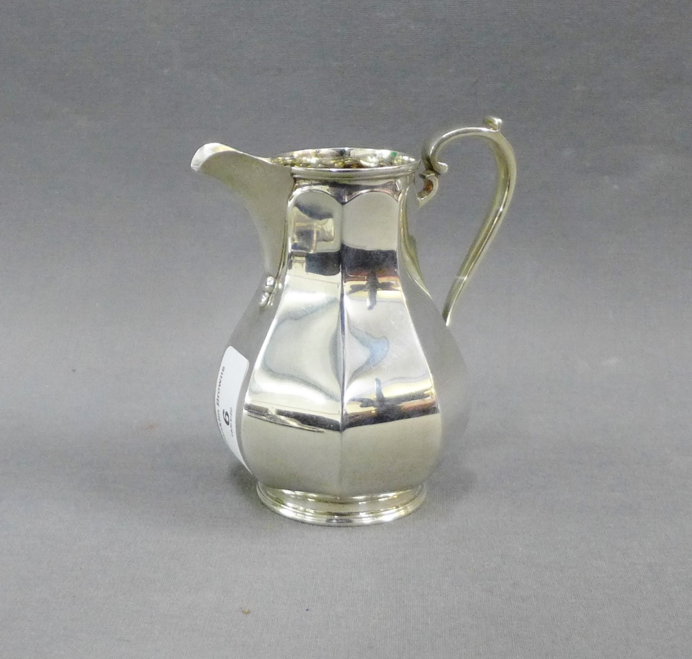 Lot 6 - George VI silver cream jug, Sheffield 1937, 12cm high