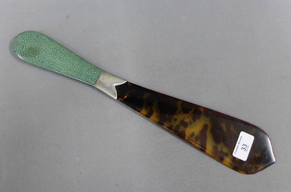 Lot 33 - Early 20th century tortoiseshell page turner with white metal collar and shagreen handle, 43cm long