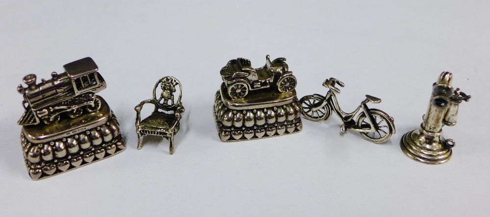 Lot 39 - A collection of silver and white metal miniatures to include a chair, telephone and bicycle, etc (5)