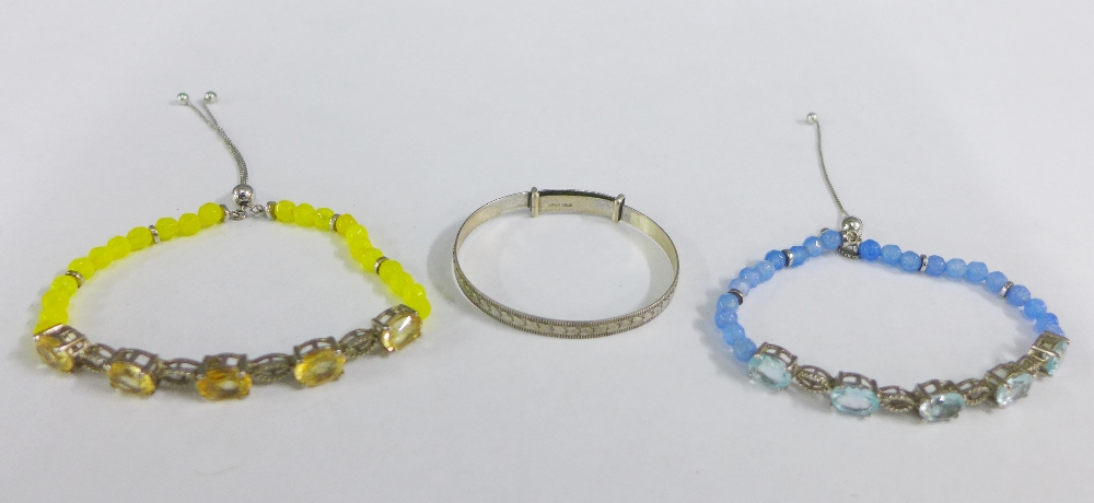 Lot 53 - Two paste set bracelets and a baby's Sterling silver bangle (3)