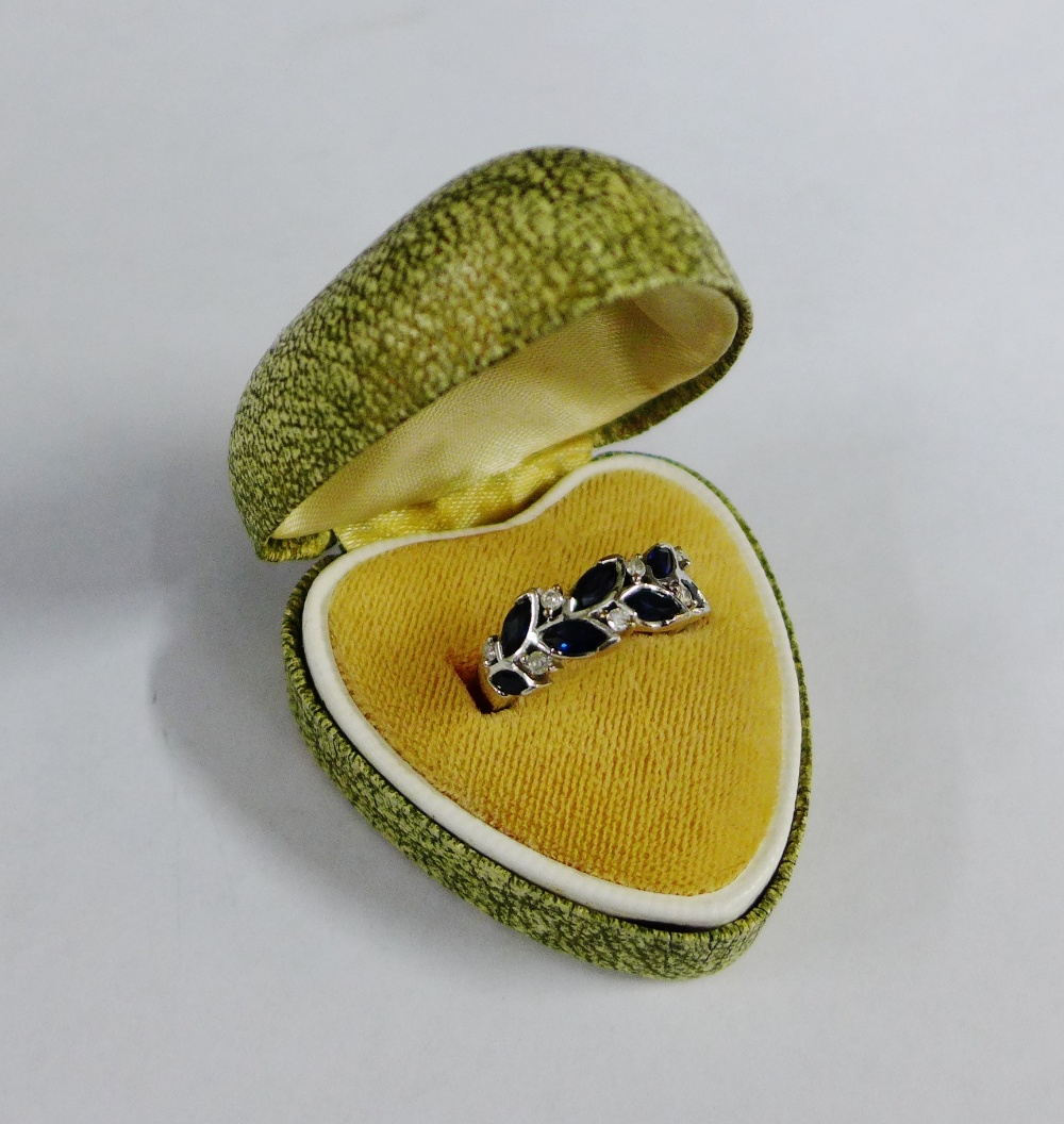 Lot 44 - 9 carat white gold sapphire and diamond dress ring, UK ring size K