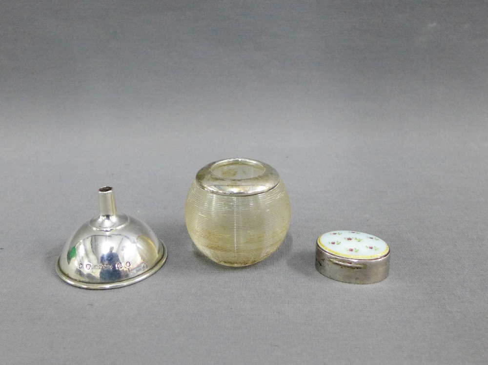 Lot 46 - A collection of silver items to include a small funnel, match striker and a pill box (3)
