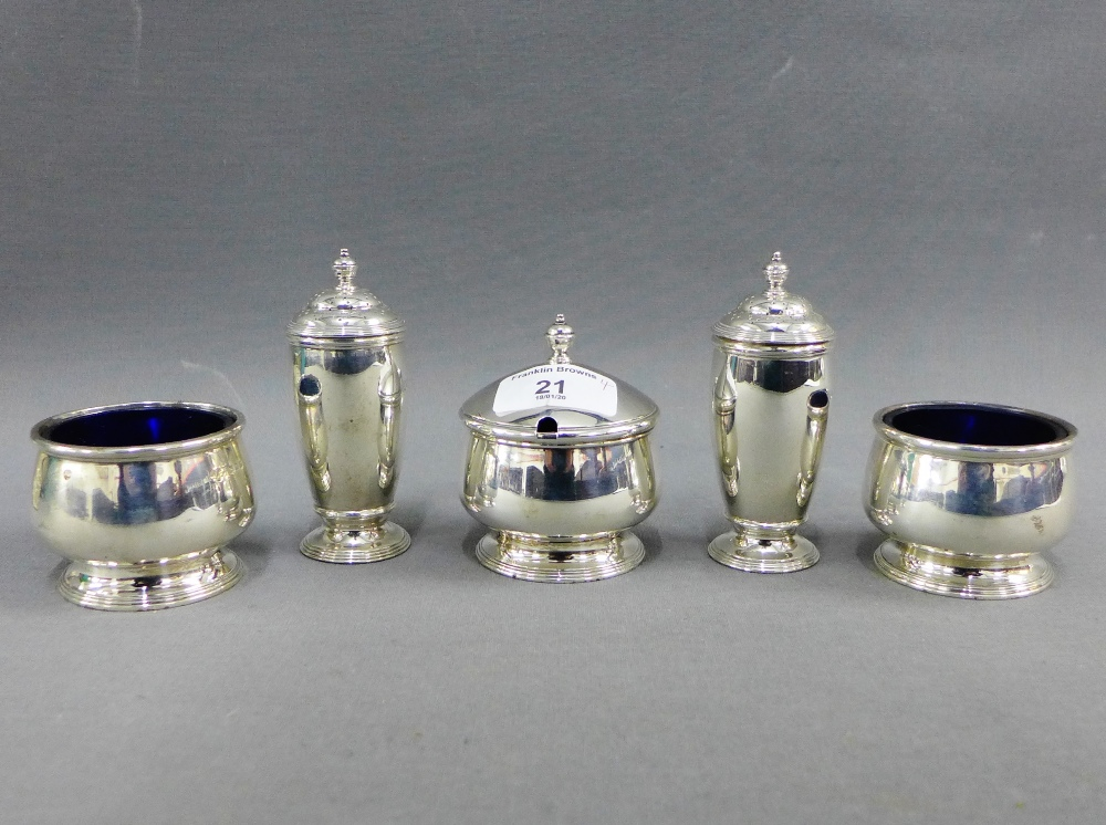 Lot 21 - George V silver four piece condiment set comprising a pair of pepper pots, two salts and a mustard