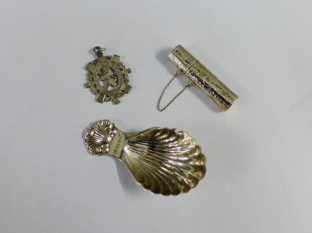 Lot 26 - Silver caddy spoon, Birmingham 1964 together with silver needle case and a Chester silver fob