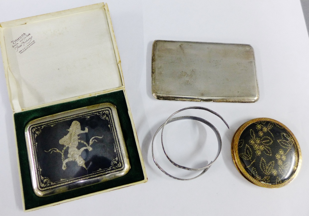 Lot 52 - Mixed lot to include a Thai white metal and niello cigarette case and another, white metal snake