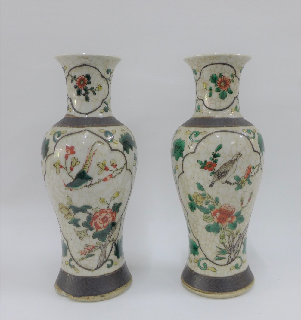 Lot 74 - Pair of Chinese high shouldered baluster vases with bird and branch pattern to a craquelure ground