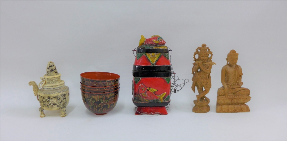 Lot 286 - A pair of eastern wooden deity's, set of four lacquered bowls and a painted wooden fish box, (a lot)