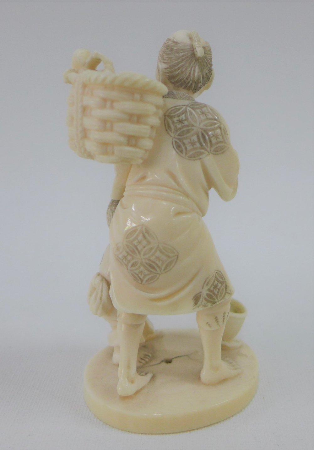 Lot 149 - Early 20th century Japanese ivory Okimono of a Fisherman, signed to the base, 9cm high