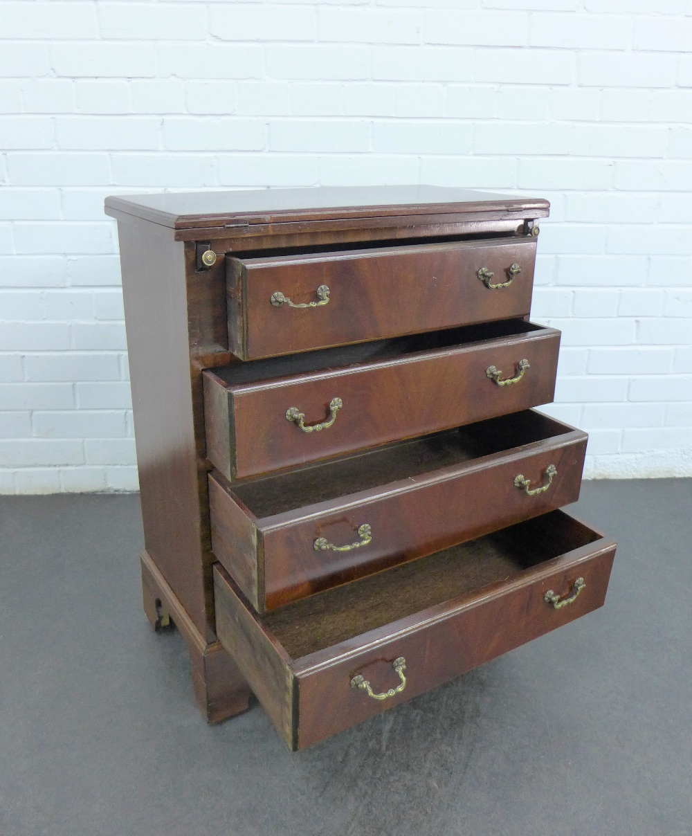 Lot 202 - A mahogany chest with a fold over top over pull slides, above four graduating long drawers, on