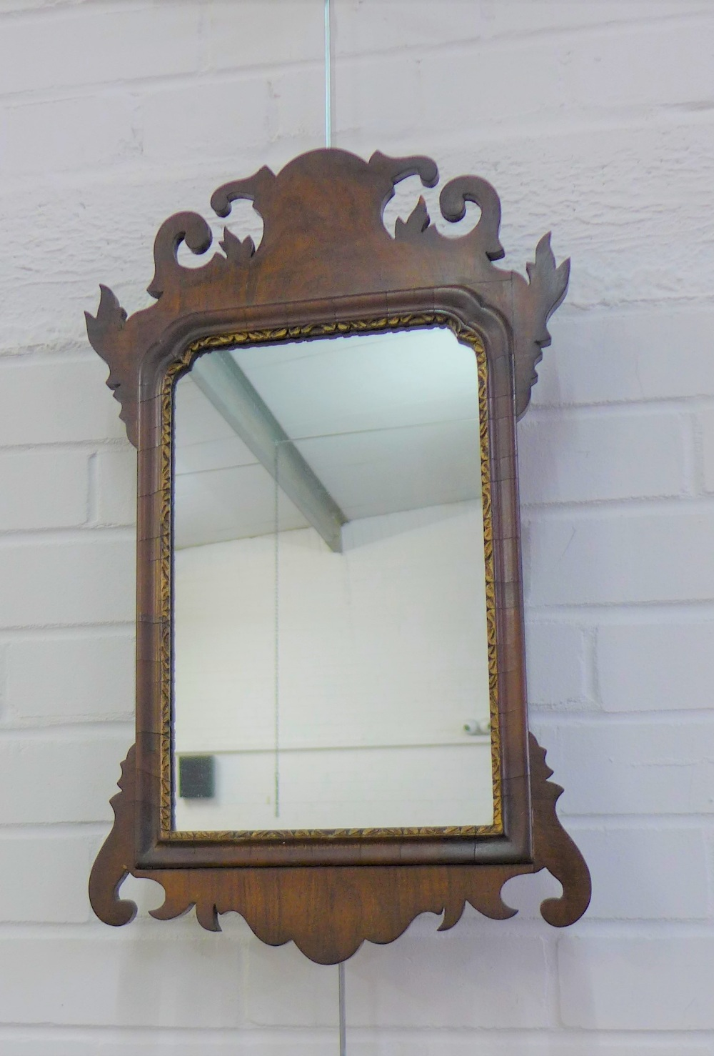 Lot 201 - Georgian style mahogany framed wall mirror with a rectangular plate, 55 x 35cm