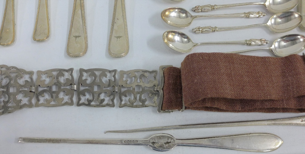 Lot 306 - Mixed lot to include a quantity of Epns flatwares, wooden candlesticks , evening gloves and chain