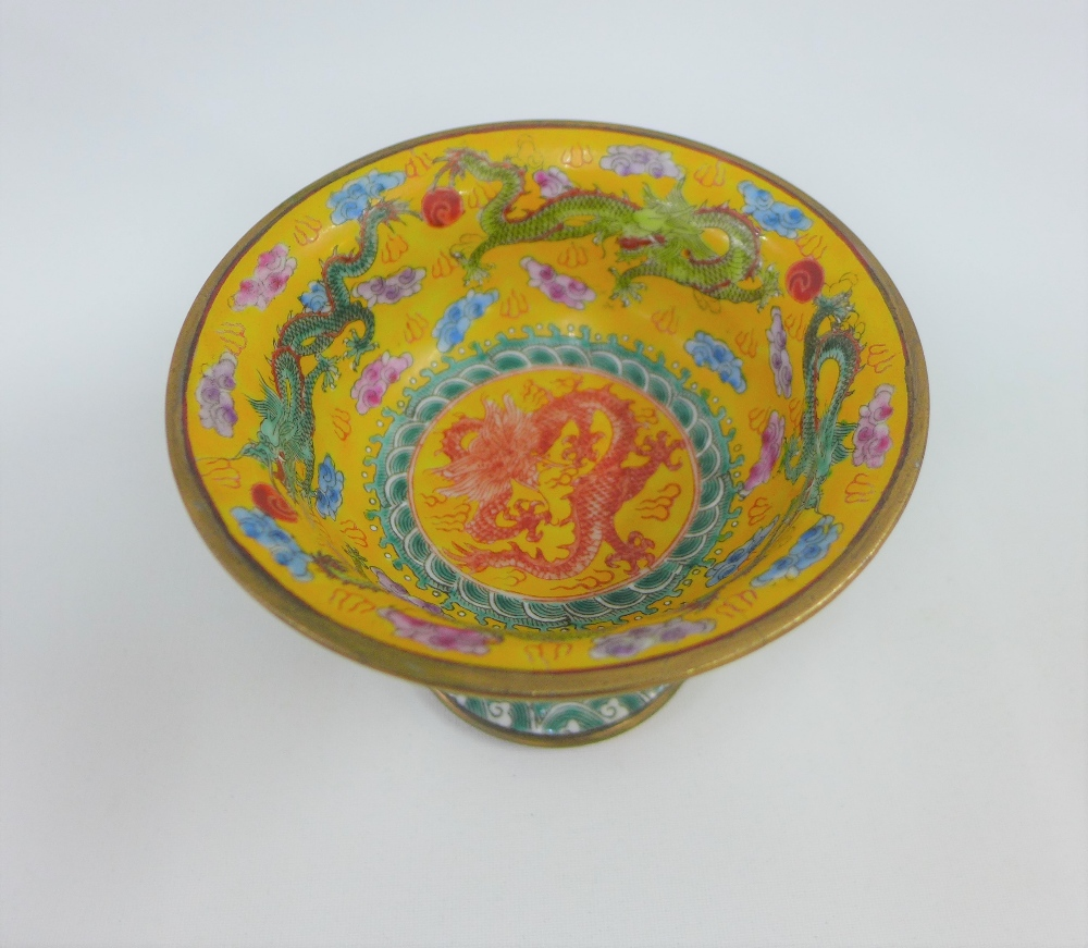 Lot 197 - 20th century yellow enamelled porcelain stem cup, in dragon pattern, with brass rims, 9 x 12cm (a/f)