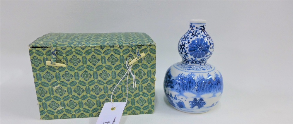 Lot 195 - A Chinese blue and white Ming style double gourd vase, boxed, 14cm high