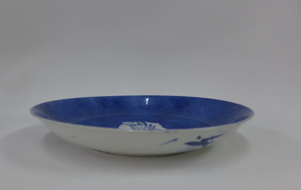 Lot 111 - Chinese porcelain shallow dish, the blue ground painted with a figure to the centre,( fritting to