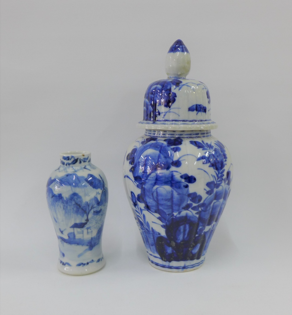 Lot 112 - A Chinese blue and white high shouldered baluster vase, Kangxi mark to the base but likely later,