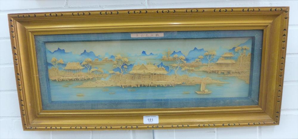 Lot 181 - Japanese School, carved wooden pagoda village scene, in glazed frame, 50 x 15cm